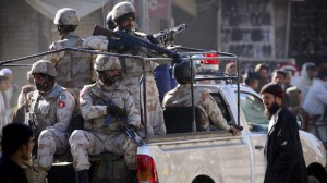 Pakistan's paramilitary soldiers patrol on a road to ensure security in Quetta, a capital of Pakistan's Baluchistan province, Monday, Dec. 13, 2010. Separatists and Islamic militants in southwest Pakistan are increasingly targeting teachers, college professors and other school officials, stunting development in the poorest corner of the country, an international rights group said. (AP Photo/Arshad Butt)