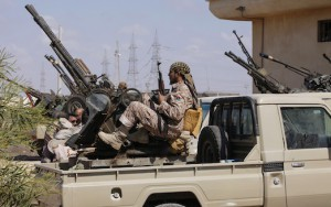 A member of the coast battalion of the Libya Shield Force Western Brigade, sits on a truck with a mounted anti-aircraft gun, after being deployed by General National Congress (GNC) President Nouri Abusahmain, in the western suburbs of the city of Tripoli August 12, 2013. Abusahmain made the decision to secure the country's capital to defend it from forces that might cause instability or remove the government from force, according to local media.                REUTERS/Ismail Zitouny (LIBYA - Tags: POLITICS MILITARY CIVIL UNREST) - RTX12IQV