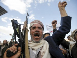 A follower of the Houthi shouts slogans as he raises his weapon during a rally against U.S. support to Saudi-led air strikes, in Yemen's capital Sanaa, March 1, 2016. REUTERS/Mohamed al-Sayaghi