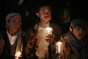 Yemeni Huthi supporters hold a candle-light vigil calling for an end to the war in Yemen, late on April 12, 2016 in Sanaa. A fragile ceasefire is set to enter a third day in Yemen despite clashes in some areas, as rebels warn the truce is in jeopardy less than a week before peace talks are due to start. / AFP PHOTO / MOHAMMED HUWAIS