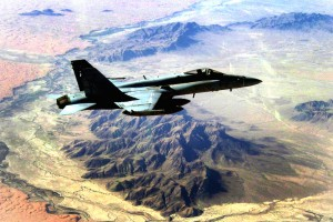 """An F/A-18C Hornet, assigned to the """"Stingers"""" of Strike Fighter Squadron 113, transits over the desert of Southern Afghanistan. The Nimitz-class aircraft carrier USS Ronald Reagan and Carrier Air Wing 14 are providing support to coalition forces on the ground in Afghanistan. Coalition forces, composed of more than 52,000 personnel from 40 countries, are providing assistance to the government of Afghanistan, as part of International Security Assistance Force (ISAF,) and working to defeat violent extremists who operate there. Ronald Reagan is currently deployed to the 5th Fleet/NAVCENT area of responsibility. Operations in the NAVCENT area of operations are focused on reassuring regional partners of the United States' commitment to security, which promotes stability and global prosperity."""