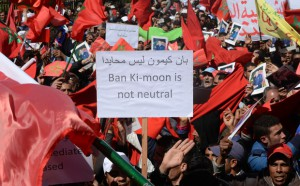 """Moroccan protesters hold placards and shout slogans in the capital Rabat, on March 13, 2016, during a demonstration against statements made by the United Nations chief earlier in the week regarding the Western Sahara, a disputed territory between Morocco and the Polisario Front, following his visit to a camp for refugees from the territory. Hundreds of thousands of people rallied in Rabat to protest against UN chief Ban Ki-moon's """"lack of neutrality"""" over Western Sahara. The UN has been trying to oversee an independence referendum for Western Sahara since 1992 after a ceasefire was reached to end a war that broke out when Morocco sent its forces to the former Spanish territory in 1975. The Algerian-backed Polisario Front is seeking independence for the territory, a demand ruled out by Morocco which argues for a broad autonomy for the territory under its sovereignty. Earlier this month Ban visited a camp in Algeria for refugees from Western Sahara as part of a regional tour and spoke of a """"human tragedy"""". He also announced plans to re-launch UN-sponsored talks between Rabat and the Polisario Front. On March 8, the Moroccan government, in a statement issued by the foreign ministry, accused Ban of speaking out of line and of allegedly using the word """"occupation"""" to describe the status of Western Sahara. / AFP PHOTO / FADEL SENNA"""