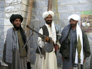 Former Taliban soldiers display their weapons during a ceremony in the western city of Herat March 10, 2009. Forty Taliban fighters surrendered to the government on Tuesday, according to local authorities. Afghanistan's Taliban on Tuesday turned down as illogical U.S. President Barack Obama's bid to reach out to moderate elements of the insurgents, saying the exit of foreign troops was the only solution for ending the war.      REUTERS/Mohammad Shoiab (AFGHANISTAN CONFLICT POLITICS)