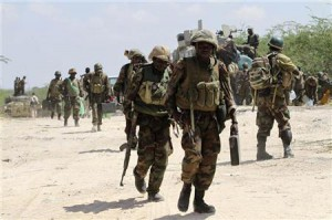 African Union Mission in Somalia (AMISOM) troops patrol after fighting against Islamist insurgents al Shabaab in Suqa Holaha village of Horiwaa district, Mogadishu March 3, 2012.   REUTERS/Feisal Omar