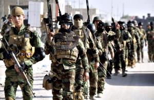 Iraqi security forces march on the outskirts of Najaf, south of Baghdad...Iraqi security forces march on the outskirts of Najaf, south of Baghdad November 19, 2014. REUTERS/Alaa Al-Marjani (IRAQ - Tags: POLITICS MILITARY CIVIL UNREST)