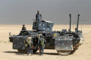 Iraqi forces hold a position on October 17, 2016 in the area of al-Shurah, some 45 kms south of Mosul, as they advance towards the city to retake it from the Islamic State (IS) group jihadists. Some 30,000 federal forces are leading the offensive, backed by air and ground support from a 60-nation US-led coalition, in what is expected to be a long and difficult assault on IS's last major Iraqi stronghold.  / AFP / AHMAD AL-RUBAYE        (Photo credit should read AHMAD AL-RUBAYE/AFP/Getty Images)