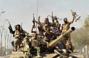 reuters_libya_sirte_fighters_20Oct11-878x578-620x408