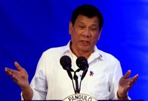 Philippine President Rodrigo Duterte gestures while delivering a speech during the 80th National Bureau of Investigation (NBI) founding anniversary at the NBI headquarters in metro Manila, Philippines November 14, 2016. REUTERS/Romeo Ranoco