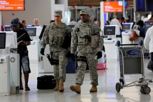 Members of the U.S. Army monitor the departures area at John F. Kennedy international Airport in the Queens borough of New York, U.S., June 29, 2016.  REUTERS/Andrew Kelly