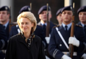 BERLIN, GERMANY - DECEMBER 17:  New German Defense Minister Ursula von der Leyen reviews soldiers of the Bundeswehr shortly after she took office at the Defense Ministry on the day the new German government was sworn in on December 17, 2013 in Berlin, Germany. The new government is a coalition between the German Christian Democrats (CDU), the Bavarian Christian Democrats (CSU) and German Social Democrats (SPD) following federal elections held in September.  (Photo by Sean Gallup/Getty Images)