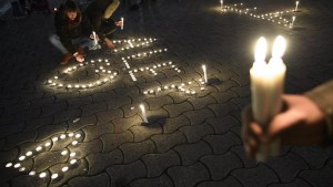 epa05677219 A close up of candles that will spell the word 'Aleppo' at a gathering of over 130 people demonstrating against the bombing of the Syrian city of Aleppo, in Lausanne, Switzerland, 15 December 2016. Aleppo's residents have been under seige for weeks and have suffered bombardment, together with chronic food and fuel shortages.  EPA/LAURENT GILLIERON