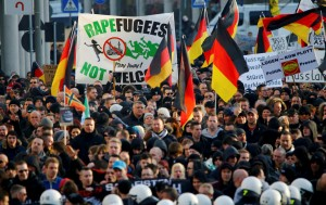 Supporters of anti-immigration right-wing movement PEGIDA protest in Cologne...Supporters of anti-immigration right-wing movement PEGIDA (Patriotic Europeans Against the Islamisation of the West) take part in in demonstration rally, in reaction to mass assaults on women on New Year's Eve, in Cologne, Germany, January 9, 2016.   REUTERS/Wolfgang Rattay ...I