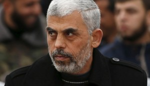 Hamas leader Yehia Sinwar attends a rally in Khan Younis in the southern Gaza Strip January 7, 2016. The rally, organized by Hamas movement, was held to honor the families of dead Hamas militants, who Hamas's armed wing said participated in imprisoning Israeli soldier Gilad Shalit, organizers said. Shalt was abducted by militants in a cross-border raid in 2006, and was released in exchange for more than 1,000 Palestinians held in Israeli jails. REUTERS/Mohammed Salem  - RTX21FPI