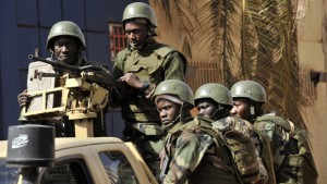 Malian troops patrol outside the Radisson Blu hotel in Bamako on November 21, 2015. Investigators in Mali are hunting at least three people suspected of links to the jihadist siege at the luxury Radisson Blu hotel in the capital that left at least 19 people dead. AFP PHOTO / HABIBOU KOUYATE        (Photo credit should read HABIBOU KOUYATE/AFP/Getty Images)