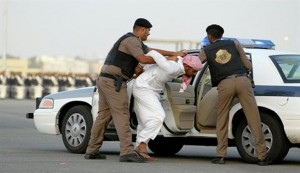 Saudi security forces are arresing a man in this file photo.